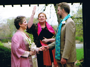 Rev. Rebecca in a garden wedding