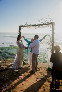 Rev. Rebecca at oceanside wedding