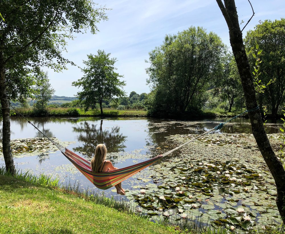 Soak up nature and sunshine in one of the hammocks by the lake.