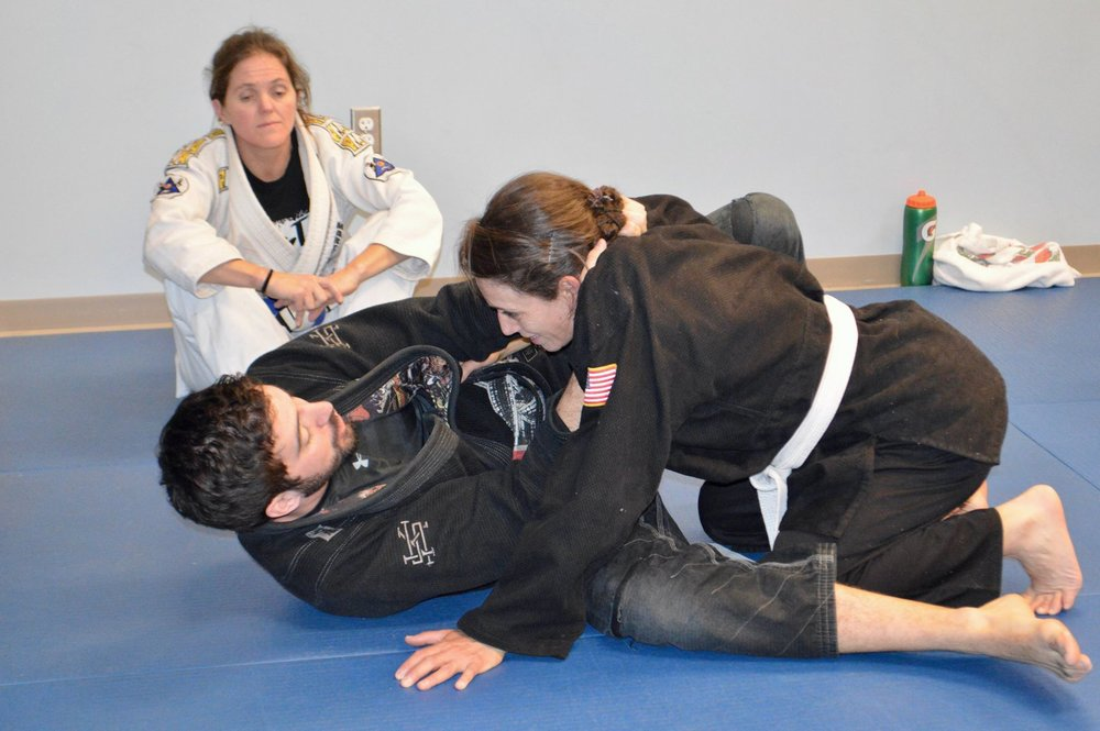Linda learning a Jiu Jitsu technique from her teacher.