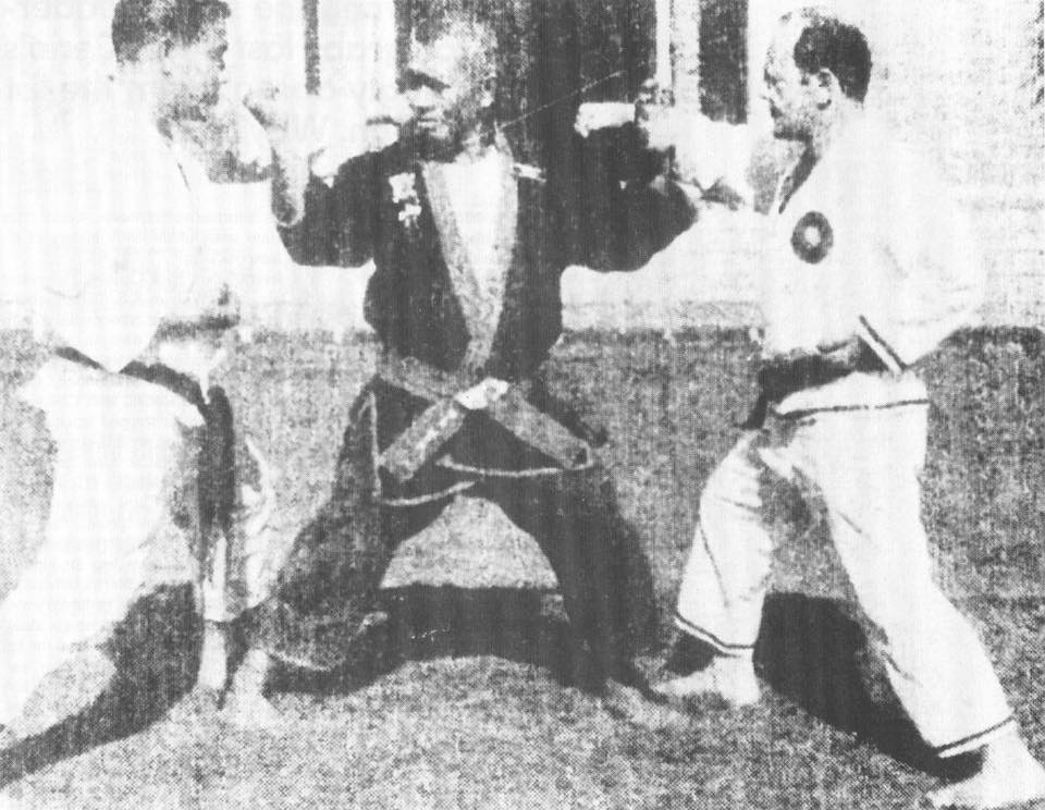 Professor Nick Cerio (right) training with Professor Chow (middle).