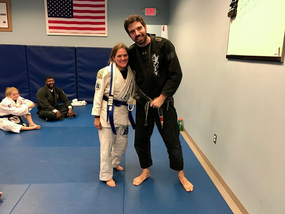 Kristie with her teacher, David Corrigan, after being promoted to Blue Belt in Brazilian Jiu Jitsu.