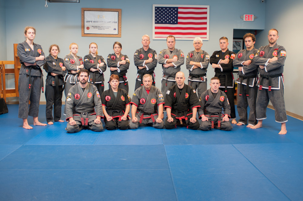 Kristie on the day she received her Black Belt, with her FILKENJUTSU Black Belt brothers and sisters.