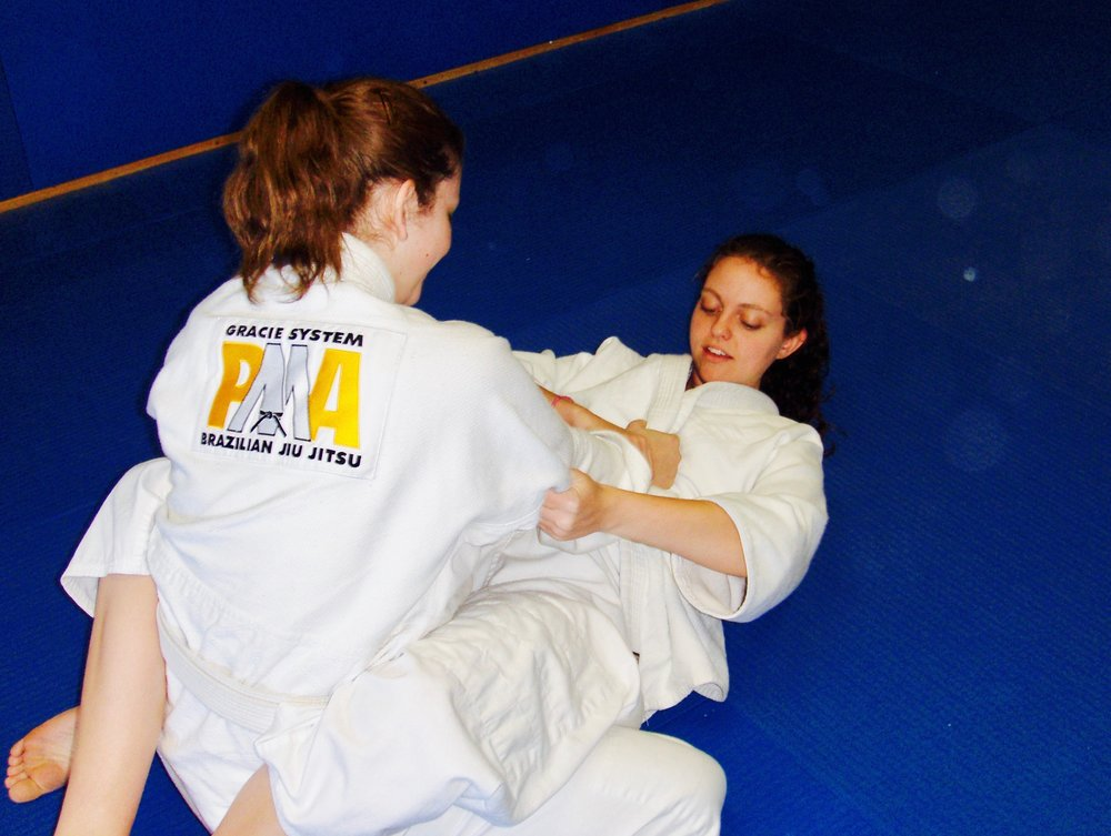 Brittany in the very beginning of her martial arts journey - training Brazilian Jiu Jitsu at 17 years old.