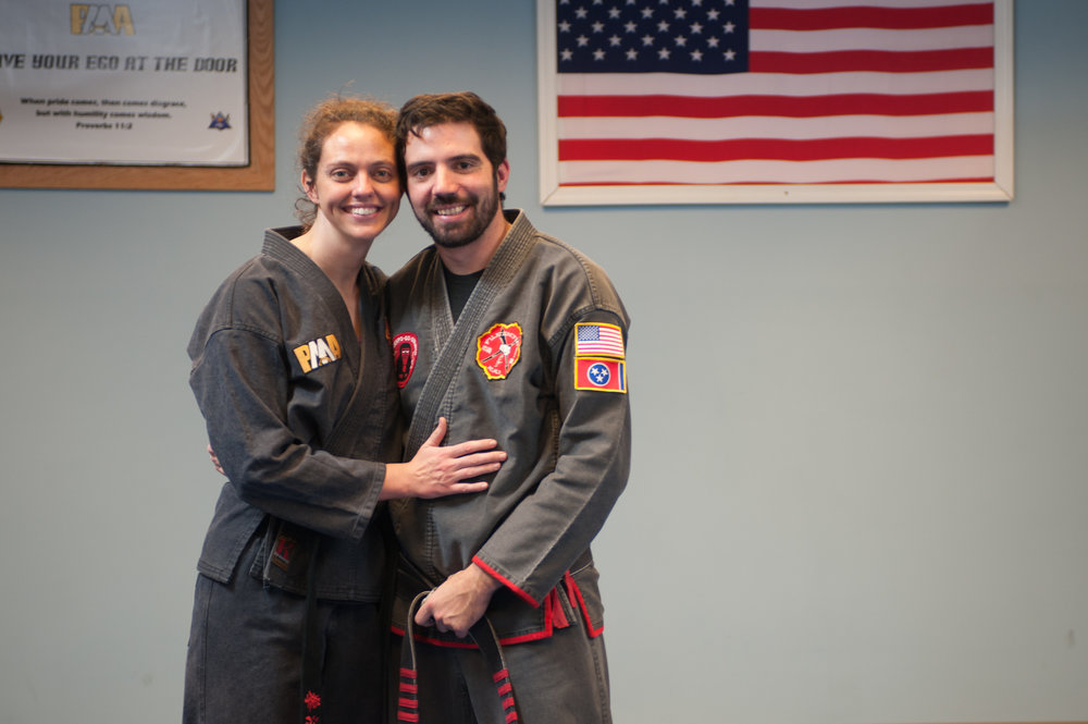 Brittany alongside her husband, David Corrigan, on the day she received her Black Belt in FILKENJUTSU Kenpo.