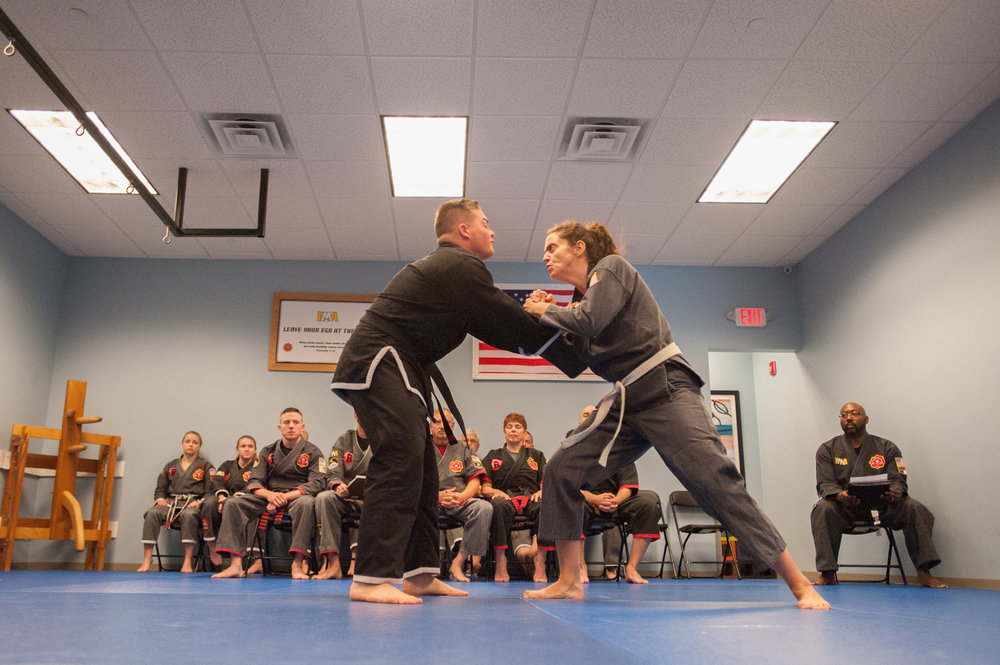 Over 60 hours into her Black Belt test, showcasing self defense techniques.