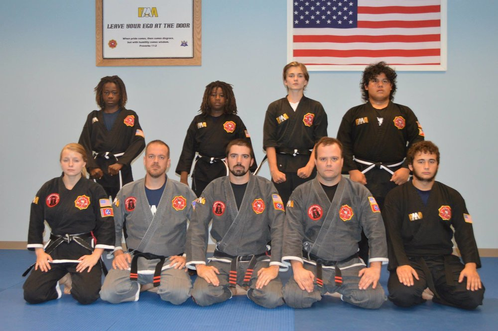 August 2015 - Iain's Junior Black Belt Test with his classmates and instructors.