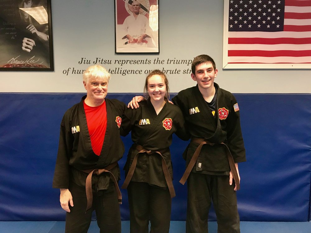Bill (on the left) alongside two of our younger students, Sadie and Mack. This picture represents the idea that martial arts training is for everyone! Gender and age do not matter!