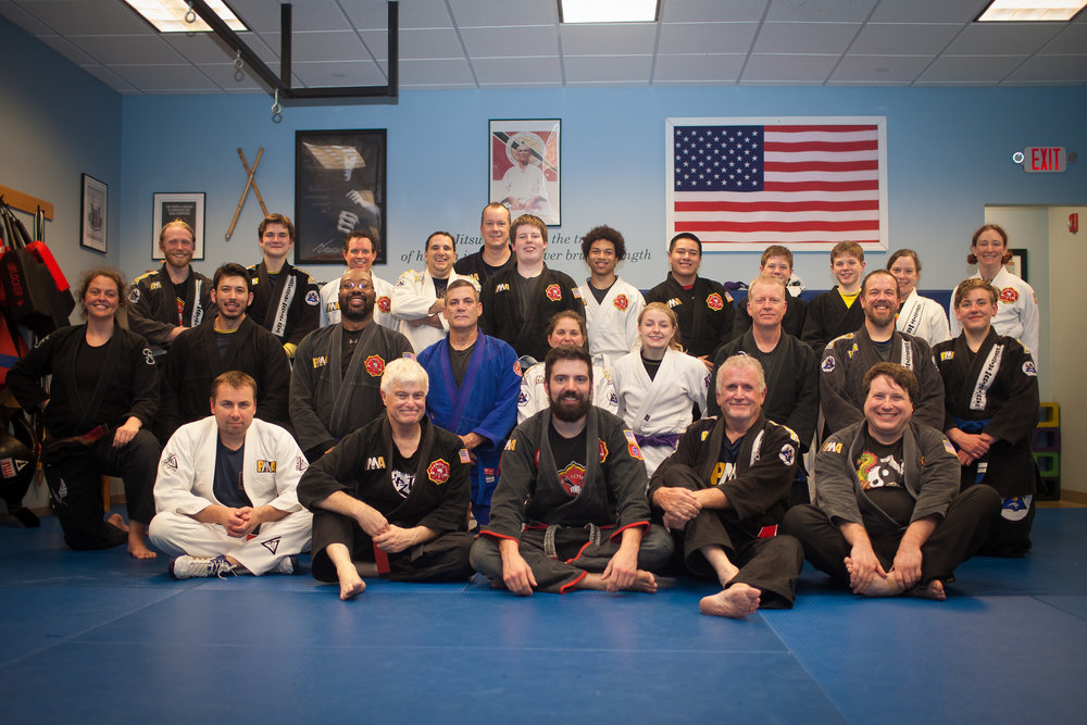 Bill (2nd from left in the front row), alongside his Brazilian Jiu Jitsu training partners. Take a look at the diversity!
