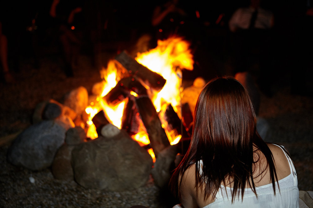 lady in front of the fire pit.jpg