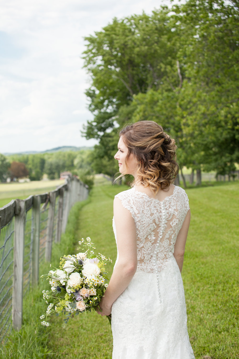 Bride at the Farm fence.jpg