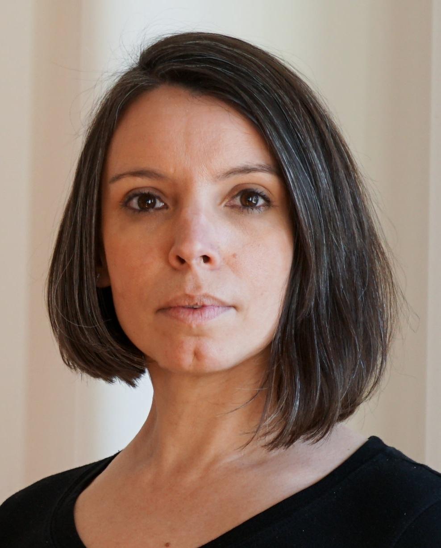 Ellie Schwetye as Miss  Gluck