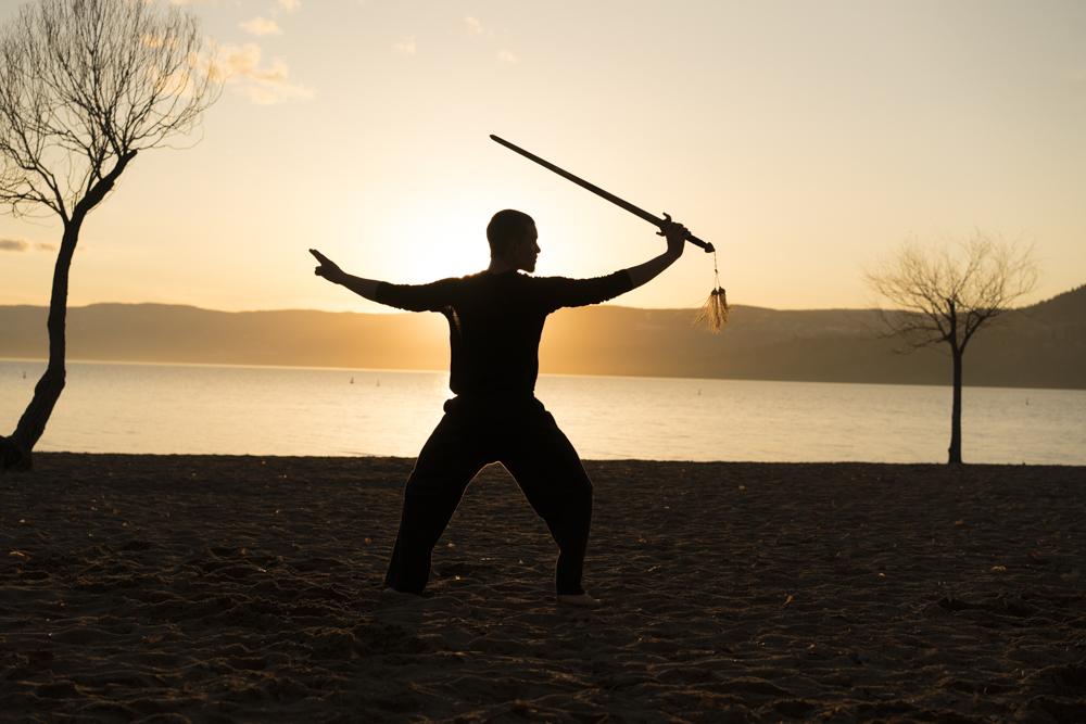 Sifu Falko practicing the Tai Chi sword at the beach.