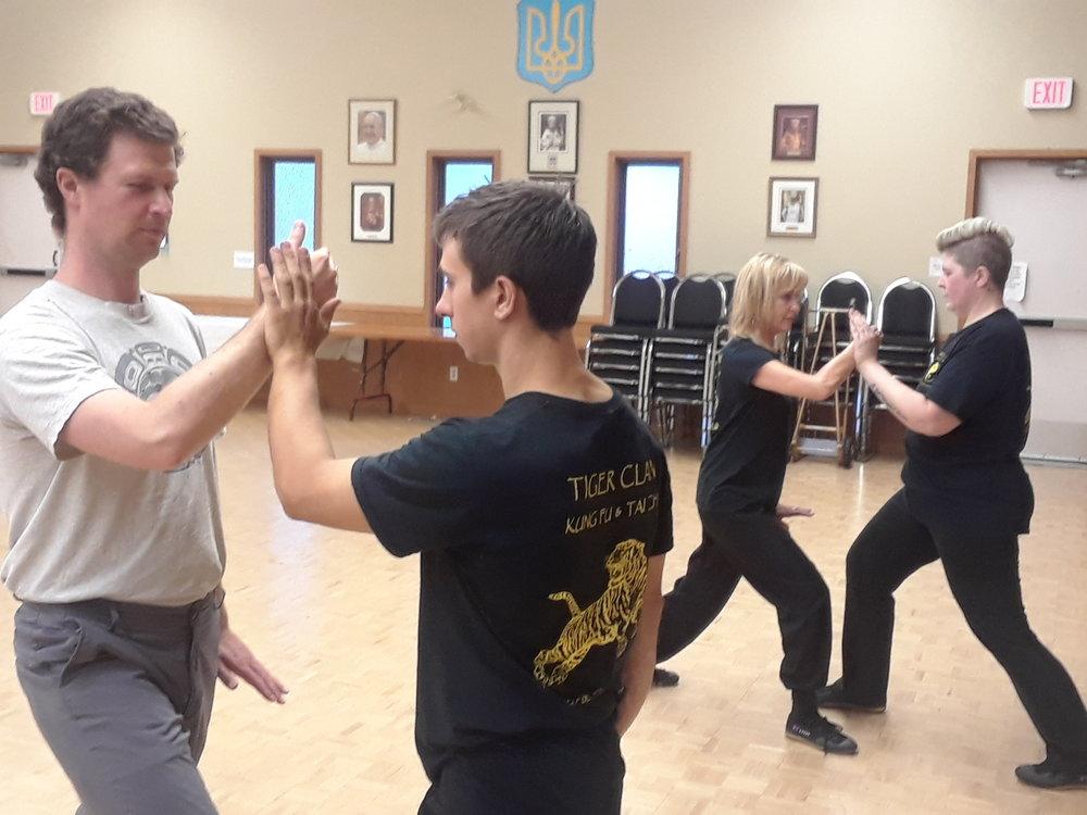 Practicing Tai Chi pushing hands.