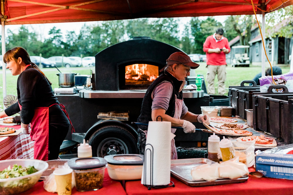 DO: Consider a mobile caterer, such as brick oven pizza! Everyone loves pizza. However, with a mobile company you will likely need to add a supplemental catering company to take care of trash removal, moving tables, and more. So think carefully.