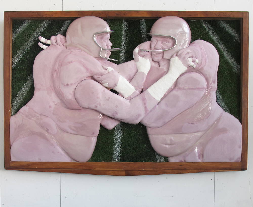 "tuesday night football,  2015.   extruded polystyrene, plaster bandages, mahogany, field turf, spray paint, aluminum armature wire, acrylic resin.  78"" x 50"" x 8""."