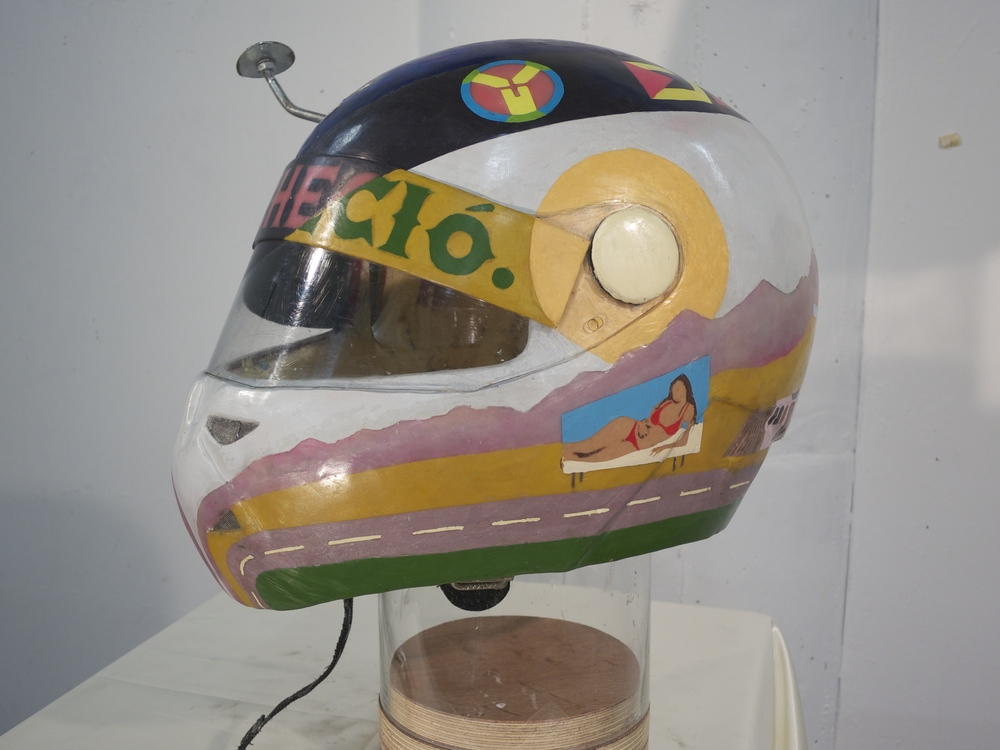 "y en sus ojos anocheció,  2012.  Modified motorcycle helmet, Bondo resin, natural Peruvian (Andean) dyes, beeswax, dammar resin, encaustic pigments, expanding foam.   12.5"" x 17"" x 15"""