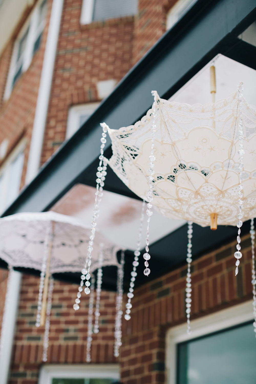 Lace parasols were hung above the entrance