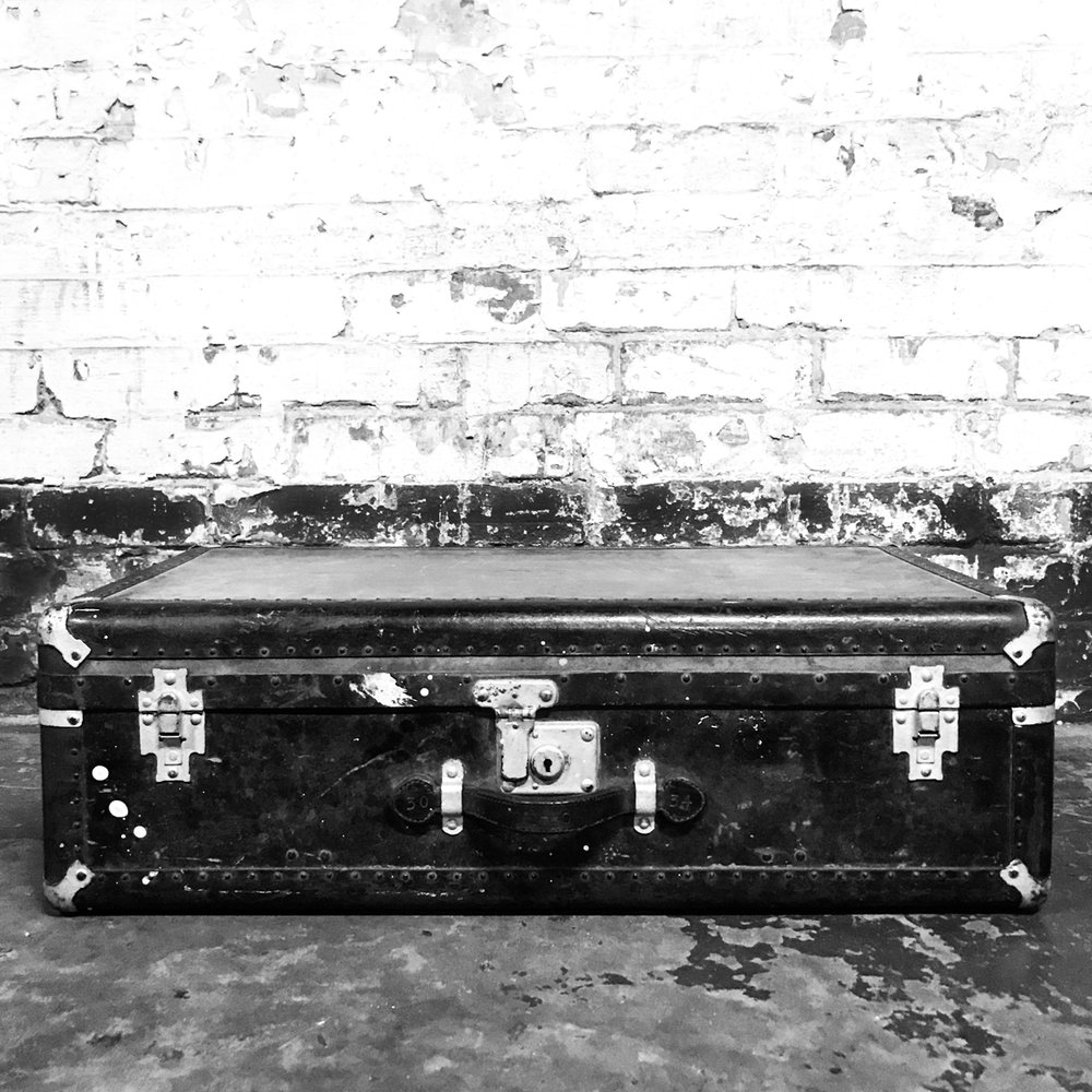SUITCASE - Olive vintage suitcase with black trim & silver locks.Ideal for toddlers or older children to sit on & super cute when they're wearing a hat.