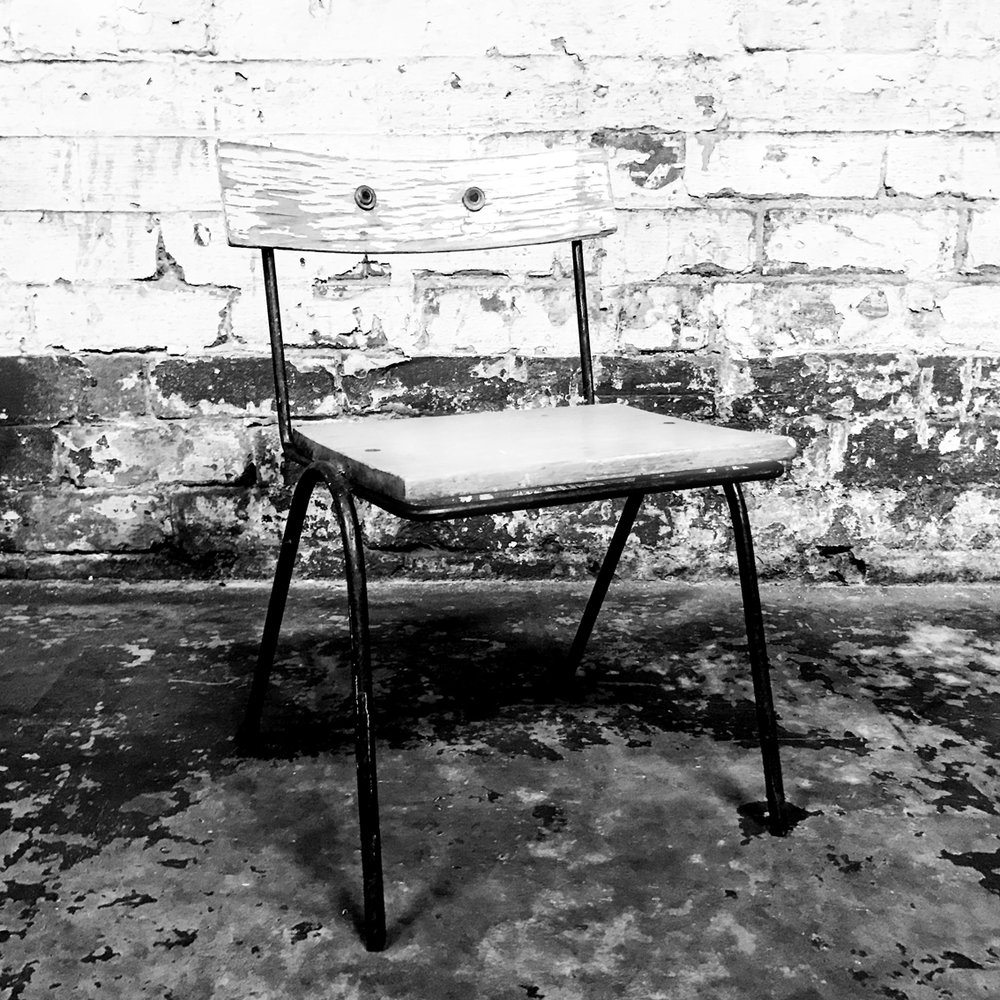 METAL CHAIR - Black metal & white timber chair.Sweet vintage child's chair so it's small & easy for little ones to sit on.