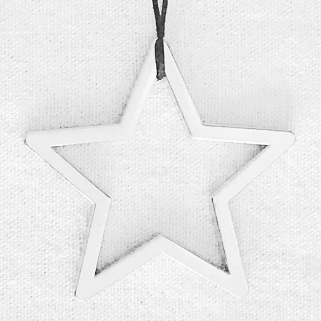 When my son was born, I started a tradition of buying 1 Christmas tree decoration every year. When he was old enough, each December, he'd help me pick the new ornament to buy & hang on our tree. I've kept a note of the year we bought each one & this silver star we bought together in 2014. My son is now 17 & they're still lovely memories for us to share every year when we decorate our tree 🌲 . #angielouphotography #christmas #christmastree #decoration #star #silver #memories #family #minimal #tradition #children #kids