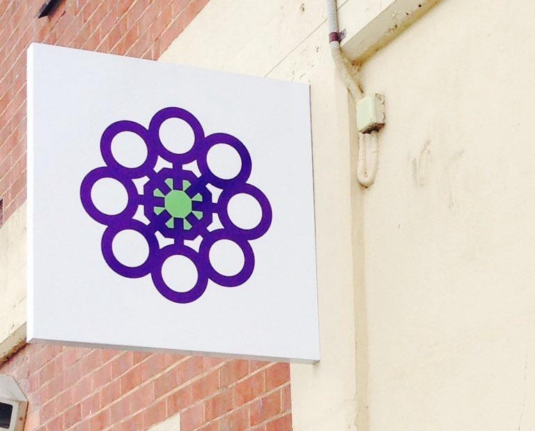 The Venus Flower logo as seen on external signage.