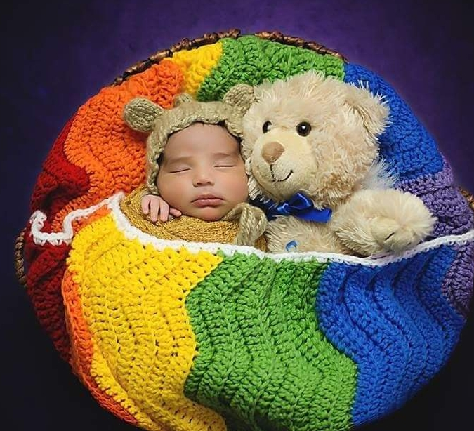"""Photo Courtesy of Tara Ruby, photographer: Abraham 02.15.2016 """"my rainbow after the storm, with his brother's teddy bear."""""""
