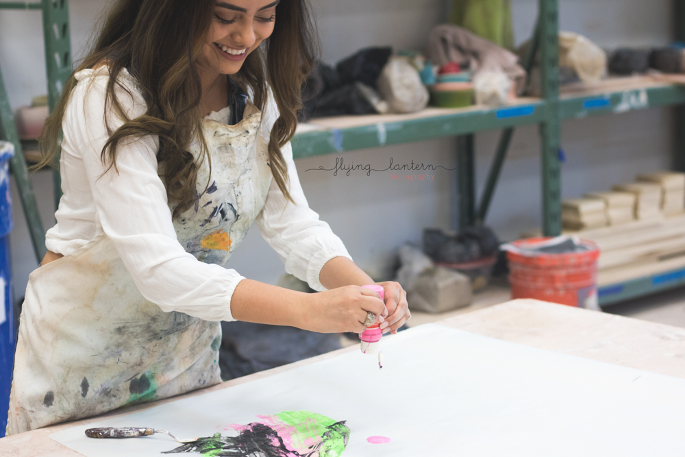 senior portrait of girl painting in lifestyle setting