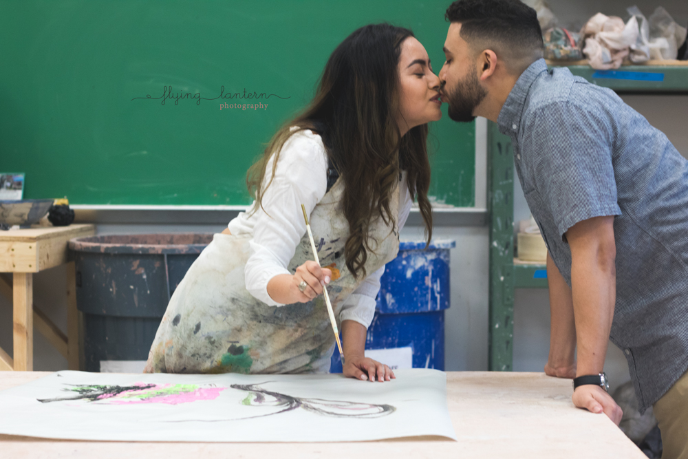 lifestyle of couple painting and kissing