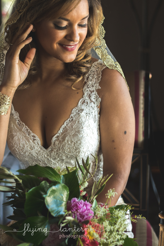 bride with bouquet and hand in hair