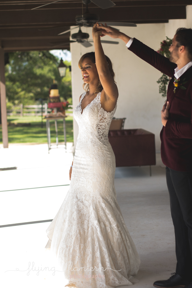 groom twirling bride