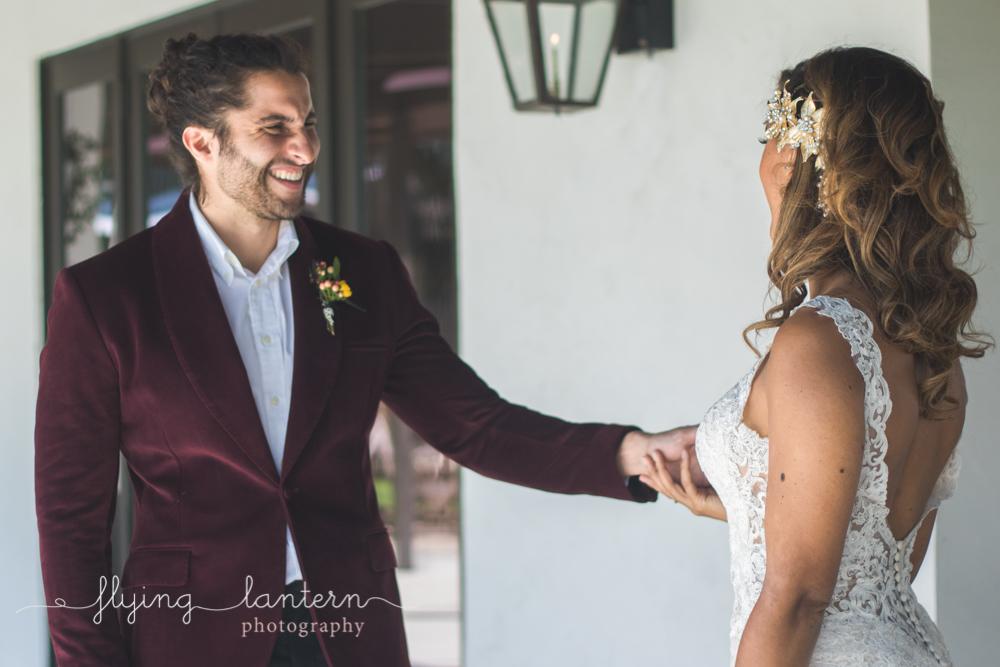groom holding bride hand grinning