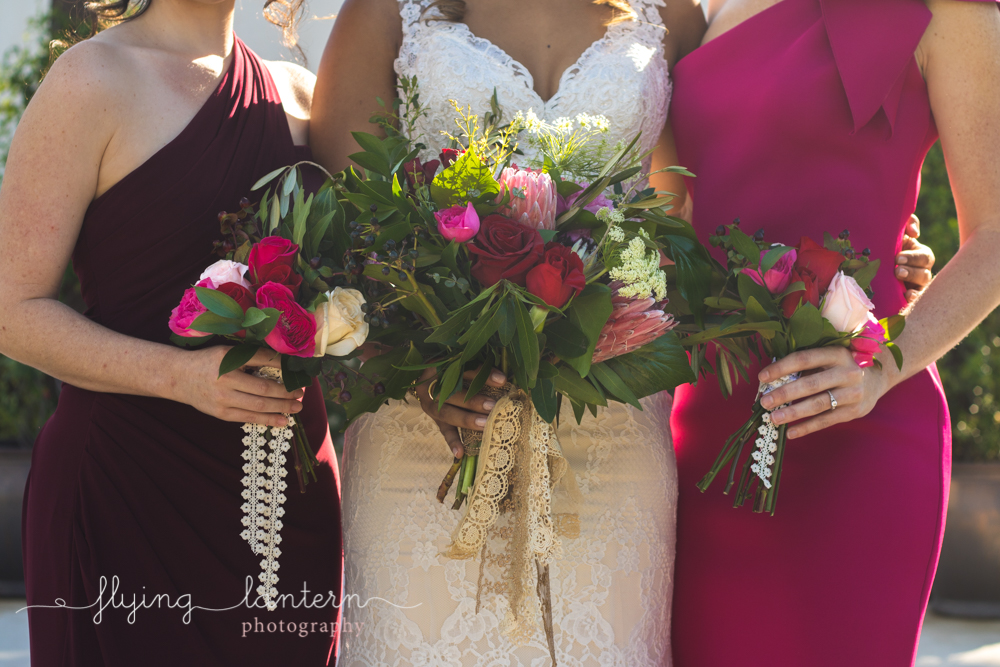 bridal and bridesmaids bouquets being held