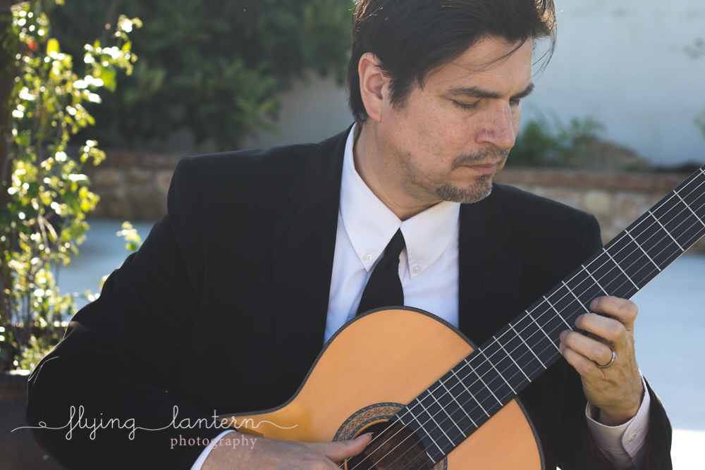 guitarist at ceremony playing a song