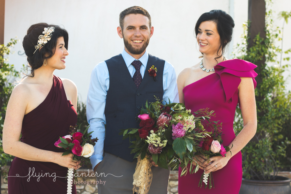 bridesmaids and bestman group photo holding bouquets