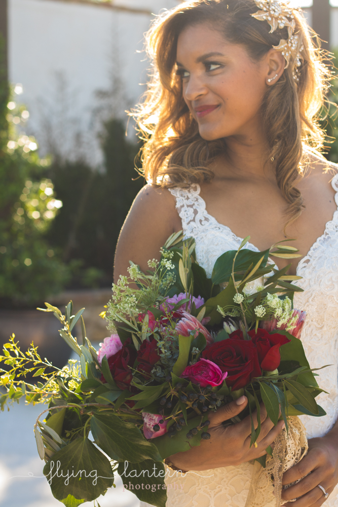 bride holding bouquet outside looking left