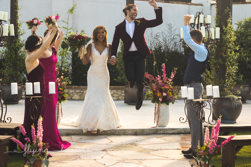 groom jumping up and cheering after getting married