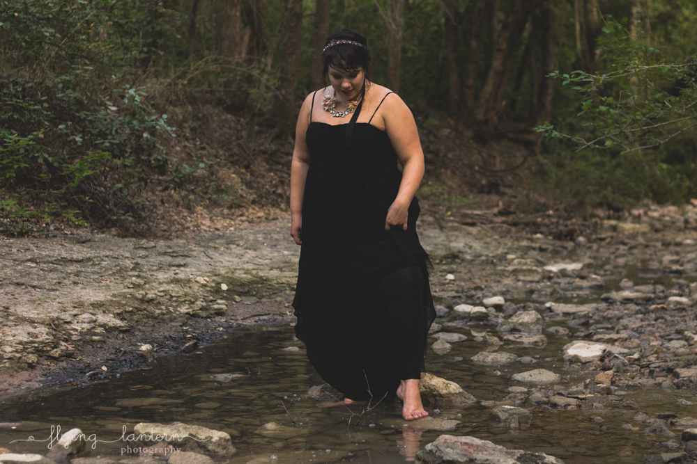 austin senior girl walking in creek barefoot