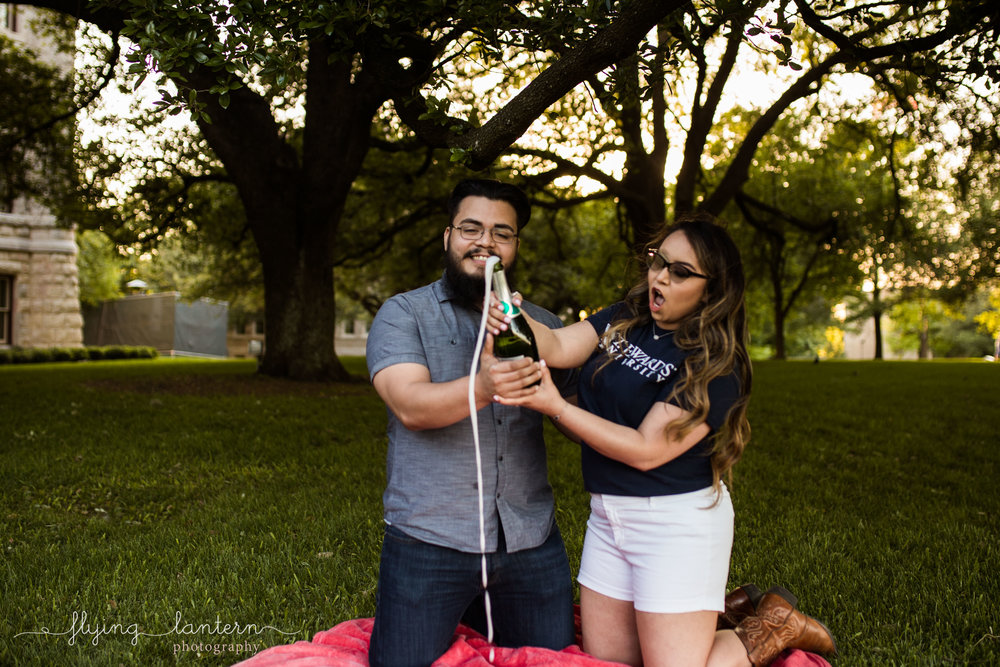 couple portrait popping champagne at st. edward's university in austin, Texas by erin Reas of Flying Lantern Photography