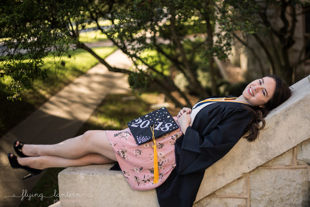 Girl senior portrait at st. edward's university with decorated cap at main building by flying lantern photography