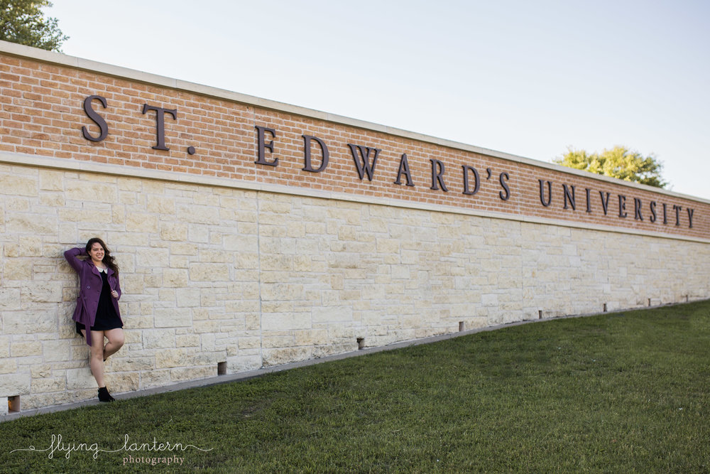 Girl senior portrait at st. edward's university in front of sign off south congress by Erin Reas of flying lantern photography