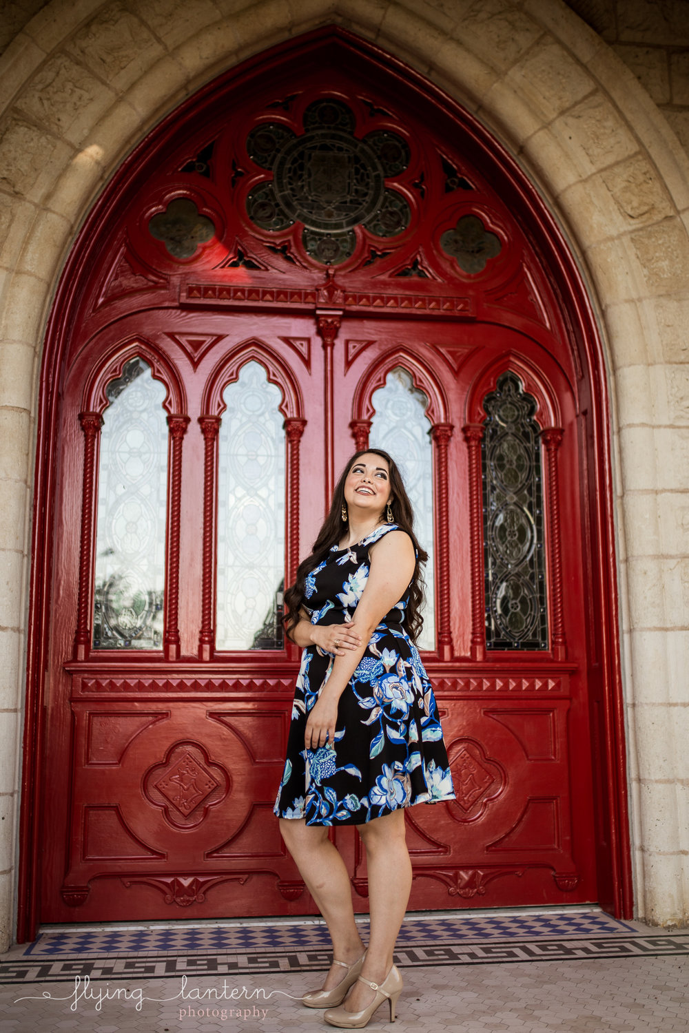 Girl senior portrait at st. edward's university red doors main building by Erin Reas of flying lantern photography