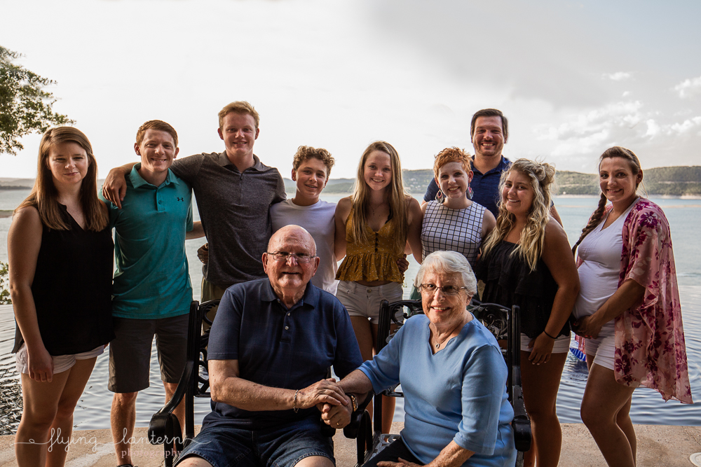 Extended family session on Lake Travis during family reunion. Grand kids and grand parents. Photo by Erin Reas of Flying Lantern Photography