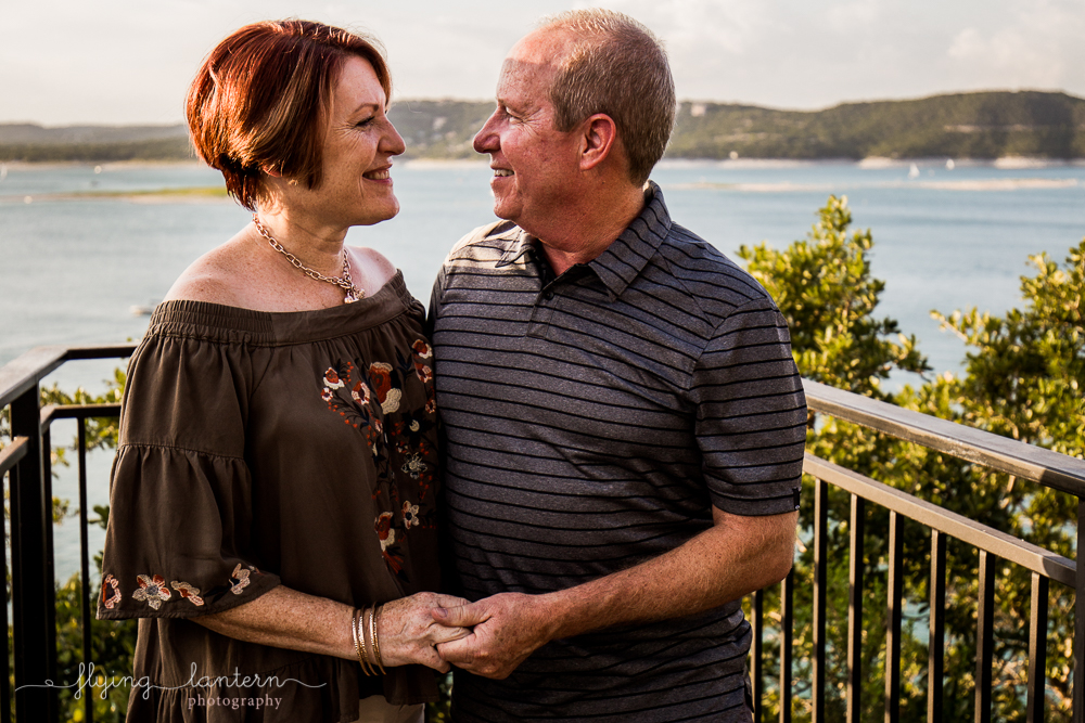 Extended family session on Lake Travis during family reunion. parents portrait smiling and holding hands. Photo by Erin Reas of Flying Lantern Photography