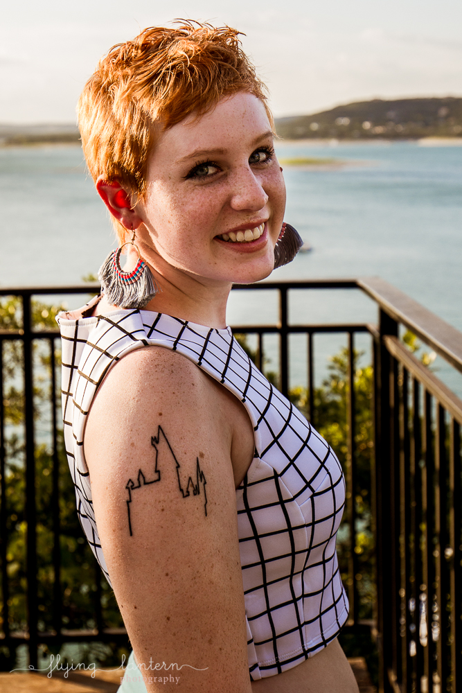 Extended family session on Lake Travis during family reunion. senior portrait female with short hair and hogwarts tattoo. Photo by Erin Reas of Flying Lantern Photography