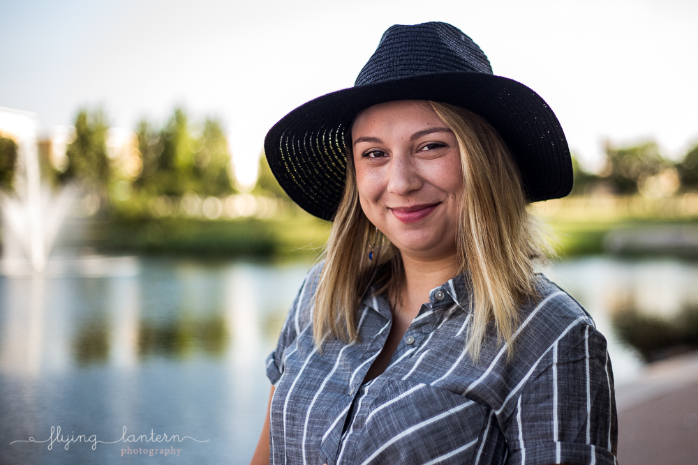 Austin food blogger lifestyle portrait session at Mueller Lake Park. Headshot. Woman wearing striped grey top and black hat. Photo by Erin Reas of Flying Lantern Photography