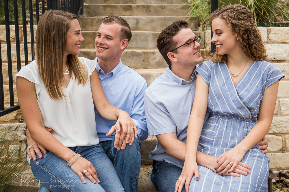 Married couples during extended family portrait session while together for family reunion weekend in Kingsland, TX. Photo by Erin Reas of Flying Lantern Photography