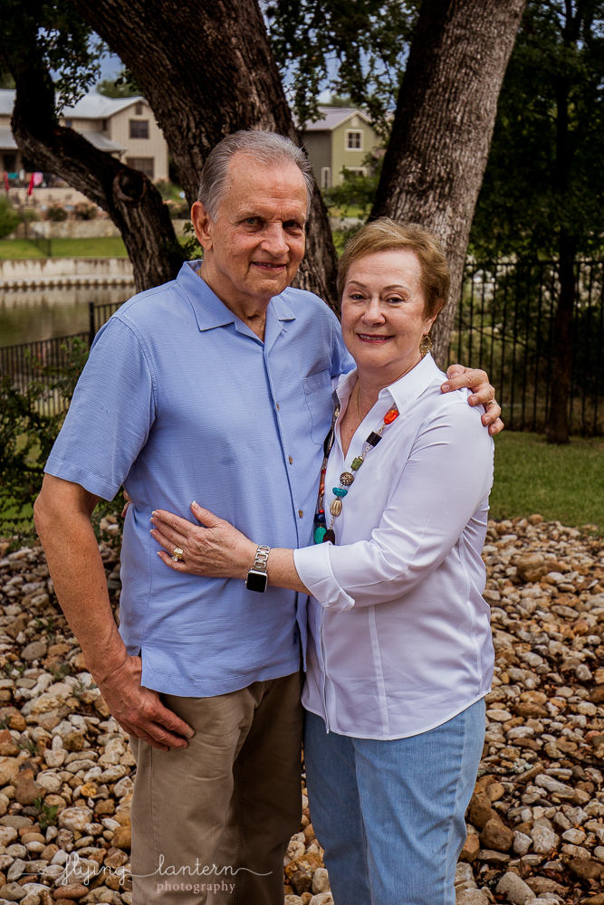 Married couple during extended family portrait session while together for family reunion weekend in Kingsland, TX. Photo by Erin Reas of Flying Lantern Photography