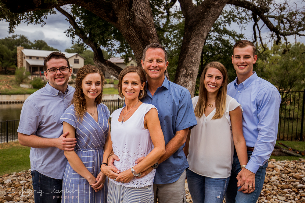 Family cluster during extended family portrait session in Kingsland, TX. Photo by Erin Reas of Flying Lantern Photography