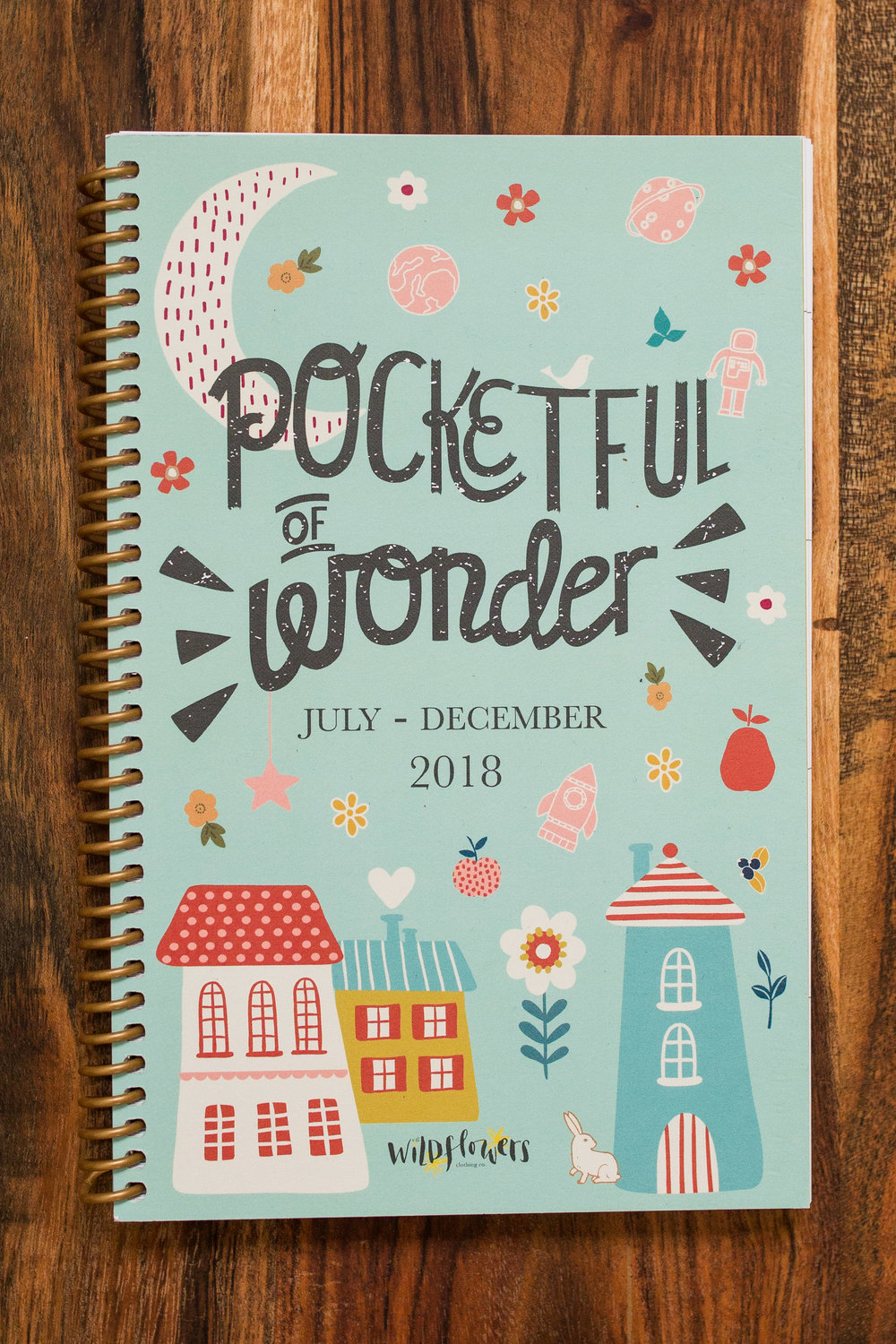 pocketful of wonder wildflowers clothing fall 2018 logo. used on planner. logo designed and handlettered by erin reas a graphic designer in austin, tx